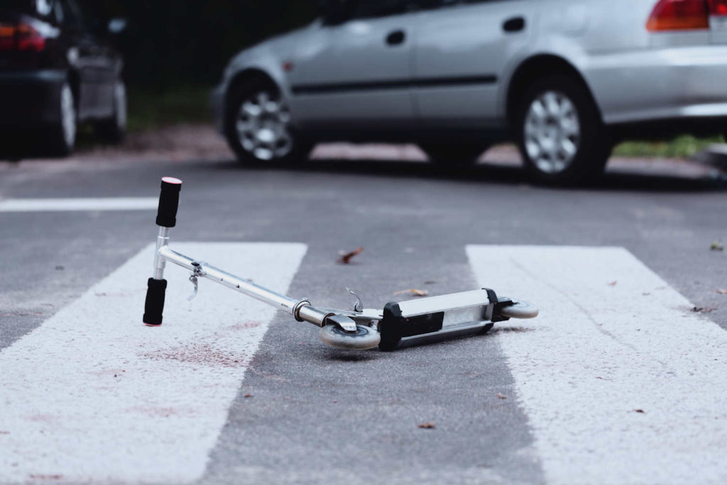 Close-up of a scooter on a pedestrian crossing. Issue of child safety on the road